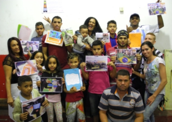 Some of the Mauá community with letters from our parishes