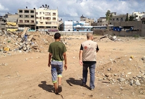 Middle-East-Gaza-Caritas-staff-walking-towards-bombed-out-flats_layout-large (A4 Landscape)