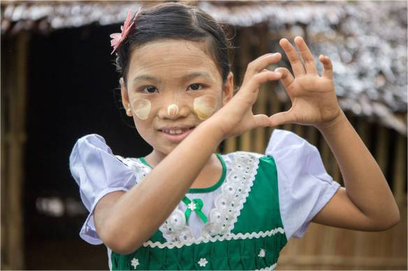 Zin Thu Thu smiles and forms a heart shape with her hands