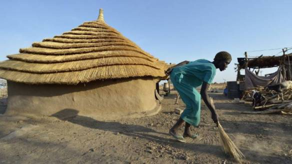 Africa-South-Sudan-woman-in-front-of-Caritas-home